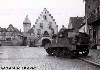 a world war two tank in a village in Alsace