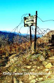 An old sign and barbed wire at Hartmannswillerkopf in Alsace France