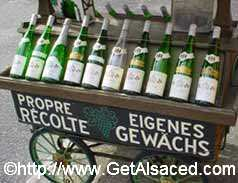 A cart with bottles of wine in Alsace