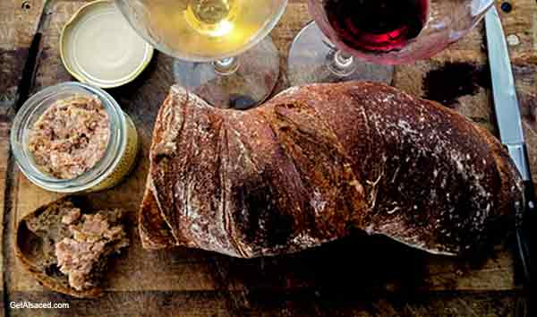 french bread, wine on a table in alsace france