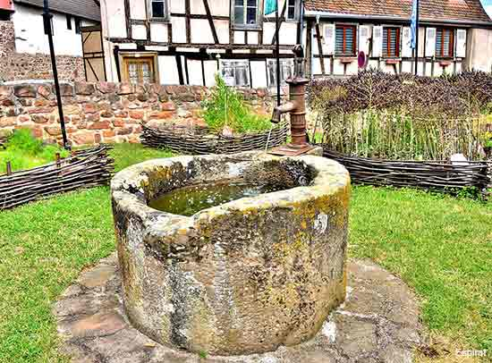 village houses and a well in the Alsace region of France