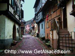 The cobble stoned medieval streets of Eguisheim on the Wine Road in Alsace