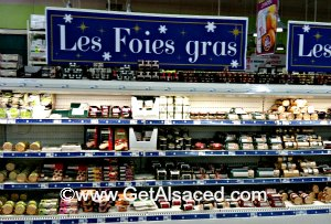 Stocked up shelves of foie gras in Alsace at Christmas time
