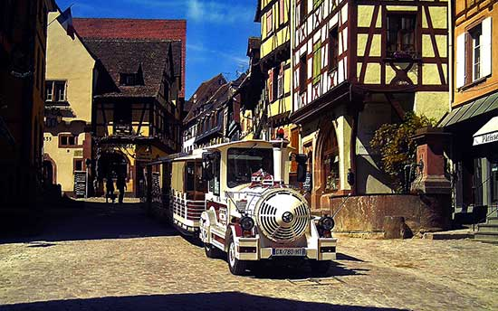 the tourist train in the Alsace village of Riquewihr in France