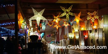 Star shaped Christmas lights at a Christmas market in Alsace