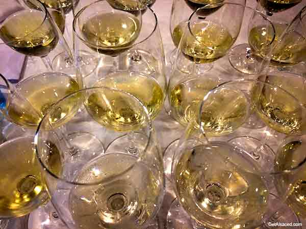 many wine glasses filled with white wine in alsace france
