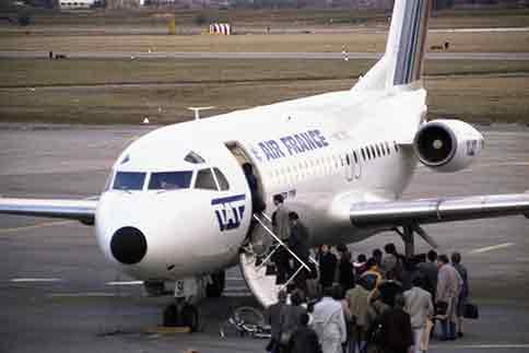 people boarding airplane in frace