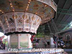 A turn of the century carnival ride at the Ecomusee outdoor history museum in Alsace France