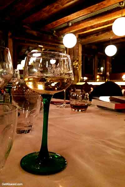 alsace wine glass on a table in a restaurant