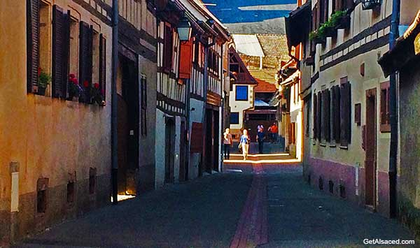 small village street on the Alsace wine road in Alsace France
