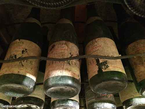 old white wine bottles in the wine cellar in alsace france